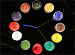 Imagine the clock with a face composed of colorful paint jars and clock hands pictured by invisible paint brush. Don't undervalue the power of imagination. In just a few seconds it could be materialized at your desktop.
