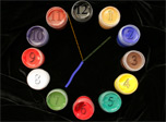 Paintbrush Clock Screensaver: the clock with a face composed of colorful paint jars!