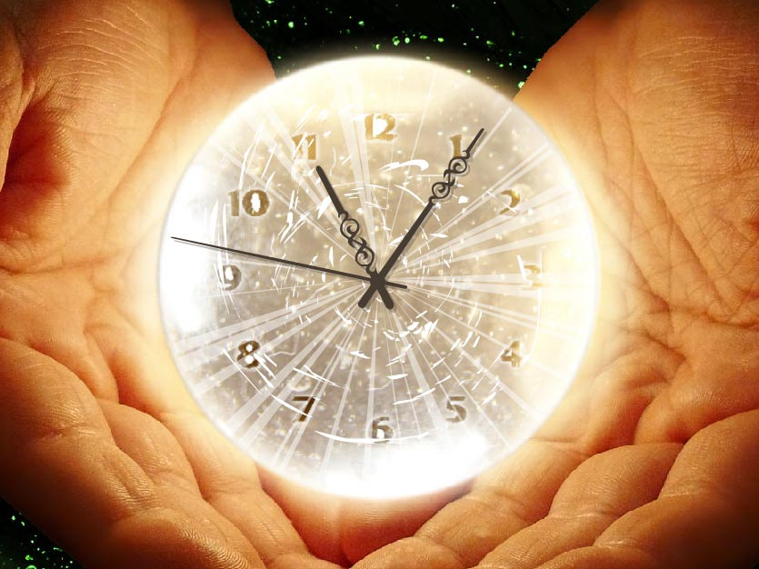 Shiny Clock Shows The Palms Of A Man Holding Shining Bulb Against